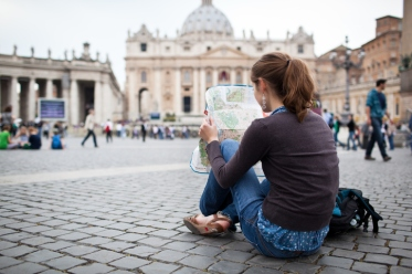 Young female tourist at St. Peter's square